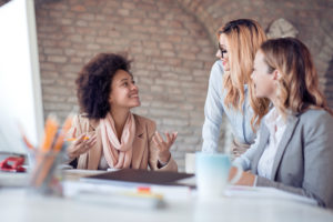 Group of business women at conference table