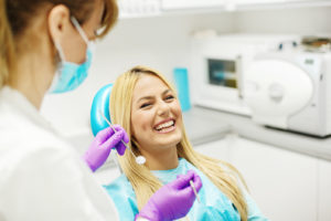 Young Woman laughing At The Dentist