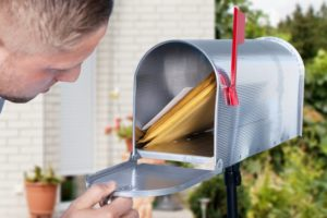 man receiving direct mail for small businesses